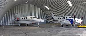 Lekkie samonośne hangary łukowe (arch prefabricated building) - hangar lotniczy postojowy TG Hangars dla General Aviation na lotnisku EPWR (Wrocław Strachowice).