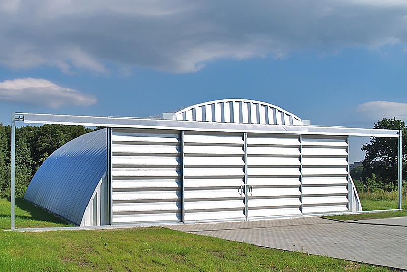 Prefabrykowana brama hangarowa TG Hangars - przesuwna (rozsuwana) lekka, zawieszana na hangarze